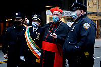 NEW YORK, NEW YORK - MARCH 17: The Cardinal Timothy Dolan (C) poses for pictures with New York Police Department members during St. Patrick's Day parade on March 17, 2021 in New York. St. Patrick's Day Parade organizers say they postpone the celebration, but a small group marched to preserve the tradition. (Photo by John Smith/VIEWpress)