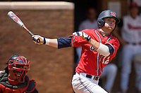 Tanner Mathis #12 of the Ole Miss Rebels follows through on his swing against the St. John's Red Storm at the Charlottesville Regional of the 2010 College World Series at Davenport Field on June 6, 2010, in Charlottesville, Virginia.  The Red Storm defeated the Rebels 20-16.  Photo by Brian Westerholt / Four Seam Images