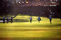 Tiger Woods walks towards the 18th green and into a multitude of fans at the conclusion of his third round of the 2000 US OPEN Golf at Pebble Beach in Monterrey, California