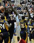 13 December 2008: Canisius' Chris Gadley pulls down a rebound in a game between Canisius and Albany won by Albany 74-46 at SEFCU Arena in Albany, New York.