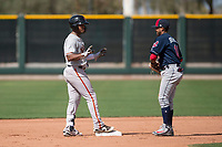 San Francisco Giants center fielder Heliot Ramos (21) jokes with Indians shortstop Aaron Bracho (10) after hitting a double during a Minor League Spring Training game against the Cleveland Indians at the San Francisco Giants Training Complex on March 14, 2018 in Scottsdale, Arizona. (Zachary Lucy/Four Seam Images)