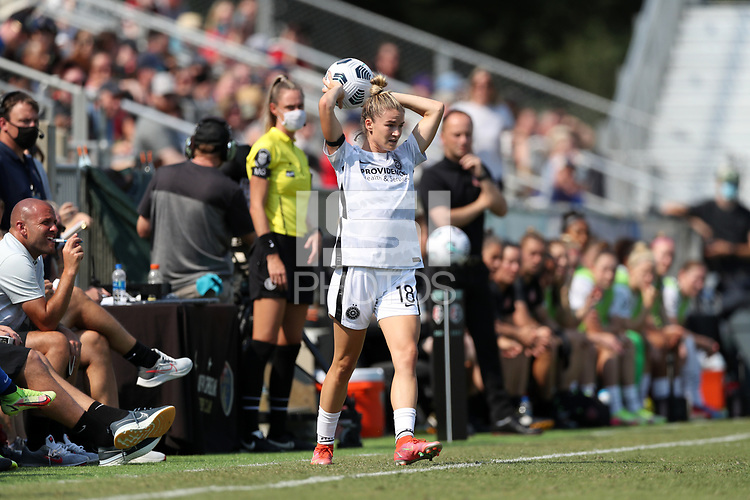 CARY, NC - SEPTEMBER 12: Christen Westphal #18 of the Portland Thorns FC takes a throw-in during a game between Portland Thorns FC and North Carolina Courage at Sahlen's Stadium at WakeMed Soccer Park on September 12, 2021 in Cary, North Carolina.