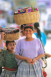Woman & Child With Baskets On Head
