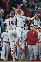 Justin Mitchell (14) of the Oklahoma Sooners celebrates with teammate Brady Lindsly (40) after hitting a solo home run against the LSU Tigers in game seven of the 2020 Shriners Hospitals for Children College Classic at Minute Maid Park on March 1, 2020 in Houston, Texas. The Sooners defeated the Tigers 1-0. (Brian Westerholt/Four Seam Images)