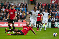 Saturday 17 August 2013<br /> <br /> Pictured: Michu of Swansea and Rio Ferdinand of Manchester United<br /> <br /> Re: Barclays Premier League Swansea City v Manchester United at the Liberty Stadium, Swansea, Wales
