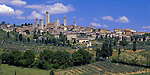 Tuscany, Italy, <br /> San Gimignano's towers and stone houses rise above nearby vineyards and olive groves