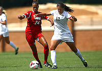WINSTON-SALEM, NORTH CAROLINA - September 01, 2013:<br /> Rachel Melhado (24) of Louisville University challenges for a loose ball with Katie Stengel (12) of Wake Forest University during a match at the Wake Forest Invitational tournament at Wake Forest University on September 01. The match was abandoned early in the second half due to severe weather with Wake leading 1-0.