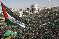 """Tens of thousands of Palestinians wave Hamas's green flag during a rally in Gaza City to mark the party's 20th anniversary, 15 December 2007. The rally is set to be the largest show of strength since the Islamists seized control in Gaza in June, routing forces loyal to president Mahmud Abbas and further deepening the economic and political isolation of the coastal strip..(photo by Fady Adwan"""""""