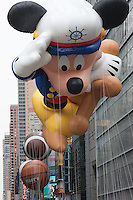 NEW YORK - NOVEMBER 25:  The Sailor Mickey helium filled balloon floats overhead during the annual Macy's Thanksgiving Day Parade  on Thursday, November 25, 2010.