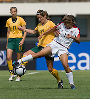 USWNT midfielder (13) Tobin Heath fights for the ball with Australia's (13) Amy Chapman during the Peace Queen Cup  in Suwon, South Korea.  The U.S. defeated Australia, 2-1, at the Suwon Sports Complex.