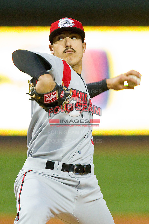 Carolina Mudcats starting pitcher Shawn Morimando (25) in action against the Winston-Salem Dash at BB&T Ballpark on April 13, 2013 in Winston-Salem, North Carolina.  The Dash defeated the Mudcats 4-1.  (Brian Westerholt/Four Seam Images)