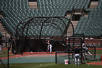 SAN FRANCISCO, CA - JULY 6:  Buster Posey #28 of the San Francisco Giants takes batting practice during summer training camp at Oracle Park on Monday, July 6, 2020 in San Francisco, California. Due to COVID-19, the 2020 MLB season has been postponed with players just beginning to return for warmups and practices while wearing masks and keeping social distance. (Photo by Brad Mangin)
