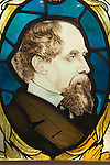 Charles Dickens stained glass window in the Charles Dickens Museum 48 Doughty Street London UK.