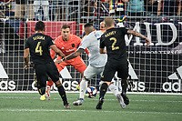 FOXBOROUGH, MA - AUGUST 3: Gustavo Bao #7 of New England Revolution approaches Tyler Miller #1 of Los Angeles FC defending the goal during a game between Los Angeles FC and New England Revolution at Gillette Stadium on August 3, 2019 in Foxborough, Massachusetts.