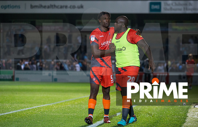 Anthony Stewart & Adebayo Akinfenwa of Wycombe Wanderers at full time during the Carabao Cup 2nd round match between Wycombe Wanderers and Forest Green Rovers at Adams Park, High Wycombe, England on 28 August 2018. Photo by Andy Rowland.