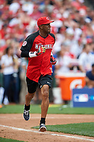 Cincinnati Reds great Eric Davis runs to first base during the All-Star Legends and Celebrity Softball Game on July 12, 2015 at Great American Ball Park in Cincinnati, Ohio.  (Mike Janes/Four Seam Images)