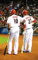 Jul. 29, 2009; Phoenix, AZ, USA; Arizona Diamondbacks outfielder (10) Justin Upton and third baseman (27) Mark Reynolds against the Philadelphia Phillies at Chase Field. Mandatory Credit: Mark J. Rebilas-