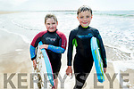 Oisin Blake and Aoife Dalton from Ballybunion waiting to catch a wave and enjoying the sunny after afternoon on Ballybunion Beach on Tuesday.