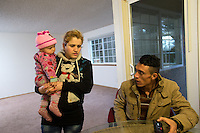 Shatha Sulaiman Kheder, 27, (center), her husband Adil Kheder Nimr, 27, and their son Steven Adil Kheder, 10 months, recollect family members still in Iraq during an interview in their new apartment in Tukwila, Wash. on January 30, 2017. The family arrived in the United States on as refugees from Iraq on January 19, 2017, the day after Donald Trump was sworn in as the 45th president of the United States, on January 30, 2017. They are concerned about thirteen of their family members still in Iraq. Trump signed an executive order last Friday restricting immigration from seven Muslim countries, suspending all refugee admission for 120 days, and bans all Syrian refugees indefinitely.  (Photo by Karen Ducey)