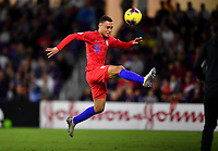 ORLANDO, FL - NOVEMBER 15: Sergino Dest #18 of the United States fly's through the air after a loose ball during a game between Canada and USMNT at Exploria Stadium on November 15, 2019 in Orlando, Florida.