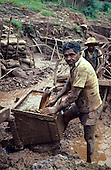 Para State, Brazil; garimpeiro in an open cast mine workers in the Serra Pelada gold mine, washing ore.