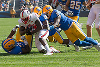 The Pitt defense makes a gang tackle. The North Carolina Wolfpack defeated the Pitt Panthers 35-17 at Heinz Field, Pittsburgh, PA on October 14, 2017.