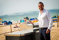 BNPS.co.uk (01202 558833)<br /> Pic: BCPCouncil/BNPS<br /> <br /> Pictured: Councillor Drew Mellor with a barbecue.<br /> <br /> A council that spent over £106,000 on installing communal barbecues on a seafront promenade had to close them over cleanliness issues. <br /> <br /> The electric cooking stations were opened to great fanfare two weeks ago by officials in Bournemouth, Dorset.<br /> <br /> Users are meant to clean up the grills after they have finished with them but most people aren't bothering.