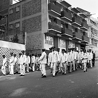 Members of the Zion Christian Church on a Sunday march along Banket Street.