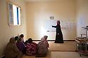Morocco - Tidzi - Hafida El Hantati, 32, teaches Arabic to the ladies working at the Ajddigue cooperative.