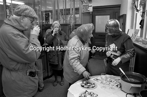 The Midland Bank, December 23rd 1994. Southfields Branch, London SW18.  Each year the manager of this branch ( my branch ) threw a Christmas Party for the staff and customers. The Fancy Dress was themed and in 1994 the theme was Robin Hood.<br /> <br /> Customers are served mince pies and punch.