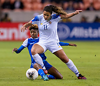 HOUSTON, TX - JANUARY 31: Raquel Rodriguez #11 of Costa Rica fights for the ball with Roseline Eloissaint #11 of Haiti during a game between Haiti and Costa Rica at BBVA Stadium on January 31, 2020 in Houston, Texas.