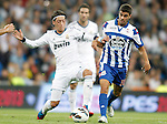 Real Madrid's Mesut Özil against Deportivo de La Coruna's Bruno Vilela during La Liga match. September 30, 2012. (ALTERPHOTOS/Alvaro Hernandez).