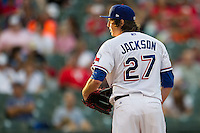 Round Rock Express pitcher Luke Jackson (27) looks to his catcher for the sign during the Pacific Coast League baseball game against the Oklahoma City RedHawks on August 1, 2014 at the Dell Diamond in Round Rock, Texas. The Express defeated the RedHawks 6-5. (Andrew Woolley/Four Seam Images)