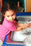 Preschool Headstart 3-4 year olds self care girl washing hands  vertical