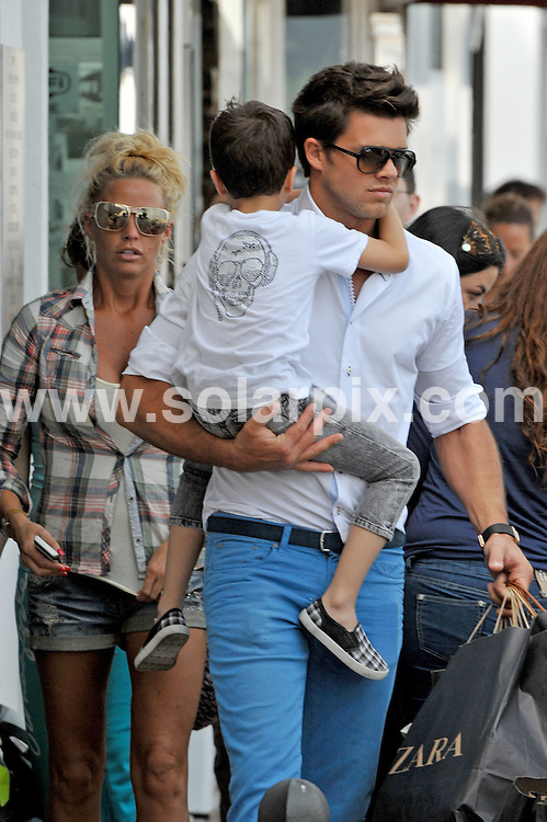 **ALL ROUND EXCLUSIVE PICTURES FROM SOLARPIX.COM**   .**WORLDWIDE SYNDICATION RIGHTS**  .**MINIMUM UK MAGAZINE PUBLICATION FEE £250.00 PER PICTURE**                                                                                   Katie Price and Argentinian boyfriend Leandro Penna took off to the shops in Puerto Banus, in Marbella this afternoon and made the most of the bad Spanish weather. Katie looked fantastic in little cut off denim shorts while Leandro sported a pair of bright blue trousers and trainers.                                                                  .This pic:      Katie Price,Leandro Penna & Junior                                                                                  JOB REF:    13484   AB1/SF      DATE:     02.06.11                                                       **MUST CREDIT SOLARPIX.COM OR DOUBLE FEE WILL BE CHARGED**                                                                      **MUST AGREE FEE BEFORE ONLINE USAGE**                               **CALL US ON: +34 952 811 768 or LOW RATE FROM UK 0844 617 7637**