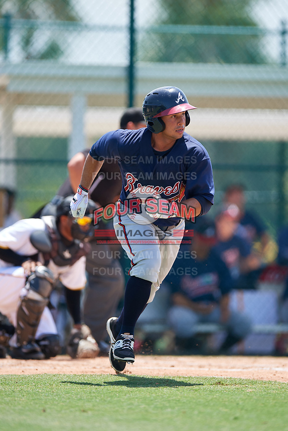 GCL Braves center fielder Carlos Baerga (64) runs to first base during a game against the GCL Pirates on July 26, 2017 at Pirate City in Bradenton, Florida.  GCL Braves defeated the GCL Pirates 12-5.  (Mike Janes/Four Seam Images)
