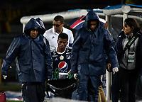 BOGOTA - COLOMBIA - 01 – 04 - 2018: Cesar Carrillo, jugador de Millonarios, es retirado en camilla de la cancha, durante partido de la fecha 12 entre Millonarios y Atletico Bucaramanga, por la Liga Aguila I 2018, jugado en el estadio Nemesio Camacho El Campin de la ciudad de Bogota. / Cesar Carrillo, player of Millonarios, is removed on stretcher of the court, during a match of the 12th date between Millonarios and Atletico Bucaramanga, for the Liga Aguila I 2018 played at the Nemesio Camacho El Campin Stadium in Bogota city, Photo: VizzorImage / Luis Ramirez / Staff.