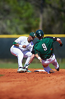 Eastern Michigan Eagles shortstop Marquise Gill (4) tags Brent Mattson (9) out while sliding into second base during a game against the Dartmouth Big Green on February 25, 2017 at North Charlotte Regional Park in Port Charlotte, Florida.  Dartmouth defeated Eastern Michigan 8-4.  (Mike Janes/Four Seam Images)