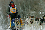 Evanston, ,Wyoming--2/3/06--10:59:35 AM-.Musher Melanie Shirilla, Lincoln, Montana; age 33, competes in the 45 mile stage along the North Slope Rd 30 miles south of Evanston along the Mirror Lake Scenic Byway during the 2006 International Pedigree Stage Stop Sled Dog Race.  Shirilla posted the fastest time in Day Seven of the International Pedigree Stage Stop Sled Dog Race (IPSSSDR) in 3:23:34.  Doug Swingley, also from Lincoln, Montana came in second with a time of 3:26:32.  Gwen Holdmann from Fairbanks, Alaska placed third in 3:30:29. Shirilla leads overall with a time of 23:03:26, followed by Jacques Philip from Nenana, Alaska in second place in  24:00:18.  Wendy Davis from Lander, Wyoming is third with a time of  24:17:43...Chris Detrick/Salt Lake Tribune.File #_2CD3555