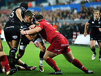 Rhys Webb of the Ospreys (R) assisted by team mate Dan Evans is stopped by Wyn Jones of the Scarlets (R) during the Guinness PRO14 Round 6 match between Ospreys and Scarlets at The Liberty Stadium , Swansea, Wales, UK. Saturday 07 October 2017