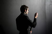CHINA. Beijing. English snooker player Ronnie 'The Rocket' O'Sullivan backstage just before going to play at the China Snooker Open. O'Sullivan has been a controversial character in snooker in recent years. He has had a troubled personal life and has outbursts of profenities at press conferences. He is arguably the most gifted ever player and has earned over 5 million British Pounds in his career. Snooker is a cue sport played on a large table measuring 3.6 metres x 1.8 metres. Originating in India in the late 19th Century where it was invented by British Army officers, the game has been a mainstay in British sport over the past few decades. Recently however, popularity of the sport has declined as the sport struggles to compete with other popular sports. The sport is however flourishing in countries such as China, where it is now the second most popular sport, behind Basketball. In a country where the  players are treated like movie-stars, China may be the great hope for the sports recovery. 2009