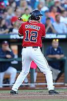 J.B. Woodman #12 of the Ole Miss Rebels bats during Game 4 of the 2014 Men's College World Series between the Virginia Cavaliers and Ole Miss Rebels at TD Ameritrade Park on June 15, 2014 in Omaha, Nebraska. (Brace Hemmelgarn/Four Seam Images)