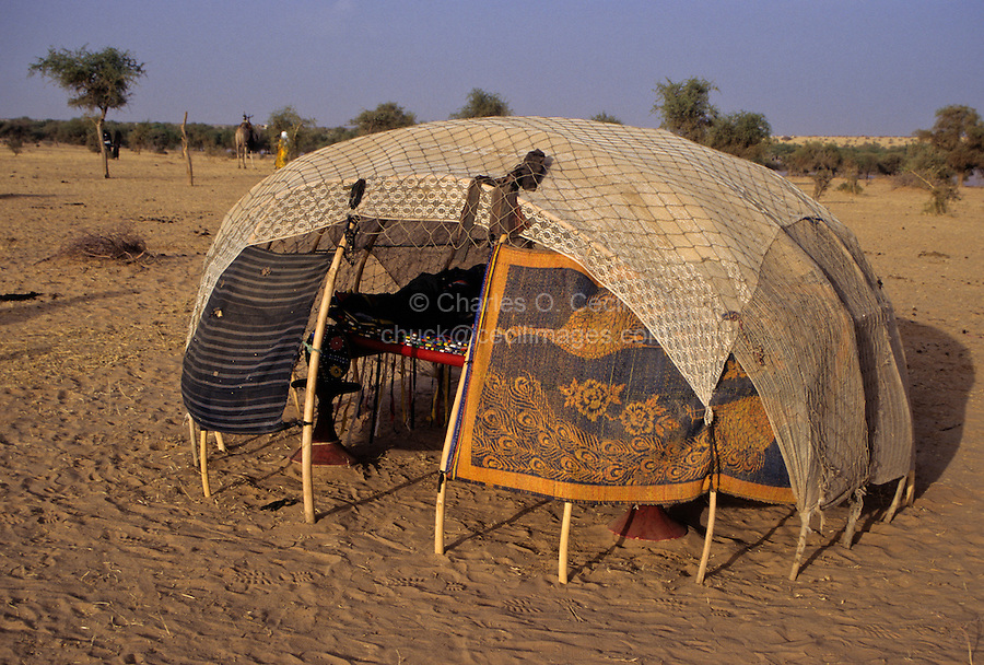 Akadaney, Central Niger, West Africa.  Fulani Nomads.  Sleeping enclosure covered with mats and fabric.