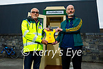 Members of the Lixnaw Development Association standing at the new defibrillator (designed like a phone box) in village on Monday evening. L to r:  Roger Craddock (First Responder) and Dick McElligott (Chairman Lixnaw Development Association)