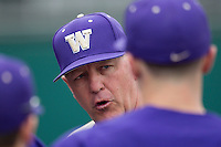 Washington Huskies head coach Lindsay Meggs talks with his team during the NCAA baseball game against the Michigan Wolverines on February 16, 2014 at Bobcat Ballpark in San Marcos, Texas. The game went eight innings, before travel curfew ended the contest in a 7-7 tie. (Andrew Woolley/Four Seam Images)