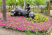 Yangzhou, Jiangsu, China.  Slender West Lake Park.  Sculpture of a Boy on a Water Buffalo.