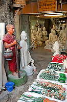 Myanmar, Burma, Mandalay.  Buddhas Carved, Sanded, and Polished from Stone  await their Buyers. Many are exported to China.