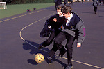 1990s Schools UK. Kids playing football in the mid morning lunch break. .Greenford High School, Middlesex  London 1990 UK 1990