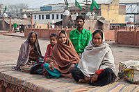 Agra, India.  Indian Muslims in the Courtyard of the Jama Masjid, the Friday Mosque.