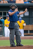Home plate umpire Quinn Wolcott indicates the count is 1-1 in a Southern League game between the Huntsville Stars and the Jacksonville Suns at the Baseball Grounds in Jacksonville, FL, Wednesday June 11, 2008.